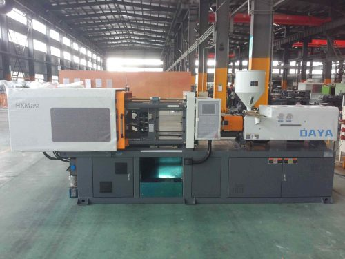 HXM 128 injection molding machine